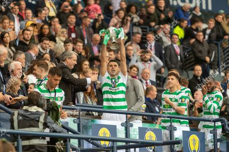 Tom Rogic holds the William Hill Scottish Cup aloft following their victory today in the William Hill Scottish Cup Final match between Heart of Midlothian and Celtic at Hampden Park, Glasgow