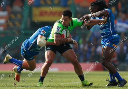 Rob Thompson of the Highlanders (C) is tackled by JJ Engelbrecht (L) and Seabelo Senatla (R) of the Stormers during the Super Rugby match between the Highlanders of New Zealand and the Stormers of South Africa in Cape Town, South Africa, 25 May 2019.