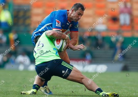 Stock Image of Rob Thompson of the Highlanders (L) is tackled by JJ Engelbrecht of the Stormers (R) during the Super Rugby match between the Highlanders of New Zealand and the Stormers of South Africa in Cape Town, South Africa, 25 May 2019.