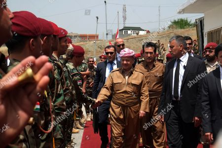 Former president of the Kurdistan Region the head of the Kurdistan Democratic Party Masoud Barzani (C) shakes hands with Peshmerga officers upon arrival to attend a graduation ceremony at Erbil Infantry military center in Soran town, 120km north east of Erbil, Kurdistan Region in Iraq, 25 May 2019. The graduation ceremony was for 1,139 Peshmerga fighters.