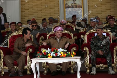 Former president of the Kurdistan Region the head of the Kurdistan Democratic Party Masoud Barzani (C) attends a graduation ceremony at Erbil Infantry military center in Soran town, 120km north east of Erbil, Kurdistan Region in Iraq, 25 May 2019. The graduation ceremony was for 1,139 Peshmerga fighters.