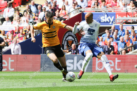 Padraig Amond of Newport County takes on Jake Caprice of Tranmere Rovers