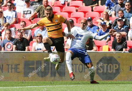 Dan Butler of Newport County and Jake Caprice of Tranmere Rovers compete for the ball