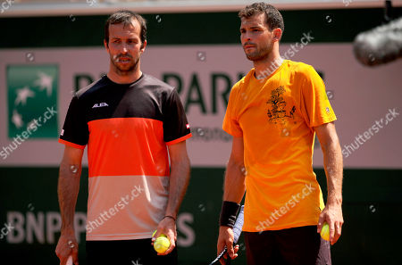 Stock Photo of Grigor Dimitrov of Bulgaria with new coach Radek Stepanek