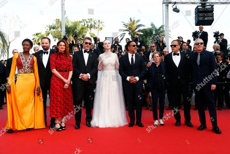 Jury members: actress Maimouna N'Diaye of Burkina Faso, Greek director Yorgos Lanthimos, Italian director Alice Rohrwacher, Polish director Pawel Pawlikowski, US actress Elle Fanning, President of the Jury, Mexican director Alejandro Gonzalez Inarritu, US screenwriter Kelly Reichardt, French director Enki Bilal and French director Robin Campillo arrive for the Closing Awards Ceremony of the 72nd annual Cannes Film Festival, in Cannes, France, 25 May 2019. The Golden Palm winning movie will be screened after the closing ceremony.