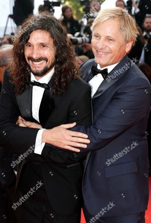 Un Certain Regard Jury member, Argentine director Lisandro Alonso (L) and US-Danish actor Viggo Mortensen (R) arrive for the Closing Awards Ceremony of the 72nd annual Cannes Film Festival, in Cannes, France, 25 May 2019. The Golden Palm winning movie will be screened after the closing ceremony.