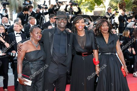 Former French soccer player Lilian Thuram (2-L) and his family arrive for the Closing Awards Ceremony of the 72nd annual Cannes Film Festival, in Cannes, France, 25 May 2019. The Golden Palm winning movie will be screened after the closing ceremony.
