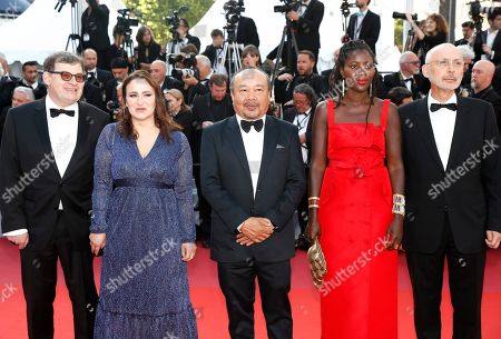 Camera d'Or Jury Members: French sound engineer Nicolas Naegelen, French filmmaker Sandrine Marques, President of the Jury, Cambodian-French director Rithy Panh, French director Alice Diop and French cinematographer Benoit Delhomme arrive for the Closing Awards Ceremony of the 72nd annual Cannes Film Festival, in Cannes, France, 25 May 2019. The Golden Palm winning movie will be screened after the closing ceremony.