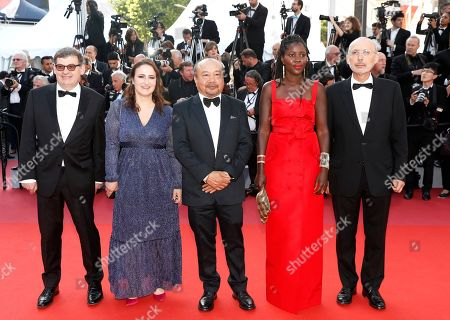 Stock Picture of Camera d'Or Jury Members: French sound engineer Nicolas Naegelen, French filmmaker Sandrine Marques, President of the Jury, Cambodian-French director Rithy Panh, French director Alice Diop and French cinematographer Benoit Delhomme arrive for the Closing Awards Ceremony of the 72nd annual Cannes Film Festival, in Cannes, France, 25 May 2019. The Golden Palm winning movie will be screened after the closing ceremony.