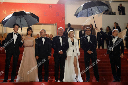 Sabin Tambrea, Catrinel Marlon, Corneliu Porumboiu, actors Vlad Ivanov, Rodica Lazar, Agusti Villaronga,Thierry Fremaux. Actors Sabin Tambrea, Catrinel Marlon, director Corneliu Porumboiu, actors Vlad Ivanov, Rodica Lazar, Agusti Villaronga and Cannes film festival president Thierry Fremaux pose for photographers upon arrival at the premiere of the film 'The Whistlers' at the 72nd international film festival, Cannes, southern France