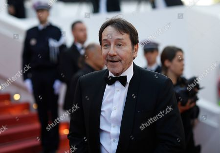 Jean-Hugues Anglade poses for photographers upon arrival at the awards ceremony of the 72nd international film festival, Cannes, southern France