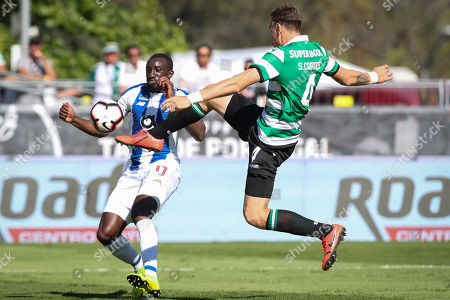 Sporting's player Sebastian Coates (R) in action against FC Porto player Moussa Marega (L)  during the Portuguese Cup final soccer match between Sporting CP and FC Porto held at Jamor stadium in Oeiras, Portugal, 25 May 2019.