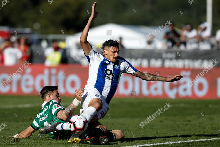 Sporting's player Sebastian Coates (L) in action against FC Porto player Tiquinho Soares (R)  during the Portuguese Cup final soccer match between Sporting CP and FC Porto held at Jamor stadium in Oeiras, Portugal, 25 May 2019.