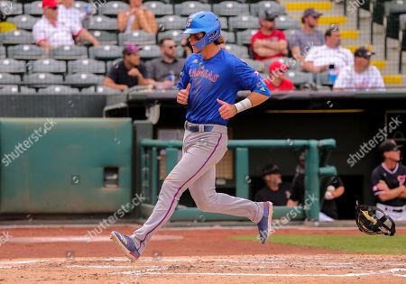 University of Kansas infielder Jack Wagner (23) crosses home plate during a Phillips 66 Big 12 Baseball Championship quarterfinal game between the Kansas Jayhawks and the Texas Tech Red Raiders at Chickasaw Bricktown Ballpark in Oklahoma City, OK