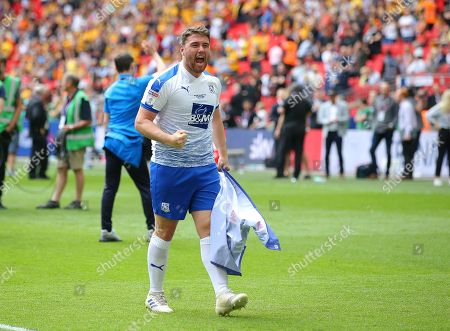Adam Buxton of Tranmere Rovers celebrates after the match