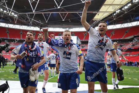 Stock Image of Adam Buxton, Jay Harris and Paul Mullin of Tranmere Rovers celebrate after the match