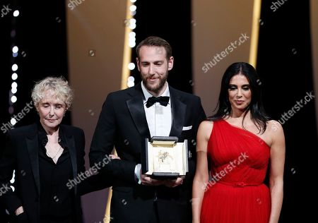 Vasilis Kekatos (C) accepts the Best Short Film Award for the movie 'The Distance Between Us And The Sky' from French director and President of the Short Films and Cinefondation Jury Claire Denis (L) and Lebanese director and President of the Un Certain Regard Jury Nadine Labaki (R) during the Closing Awards Ceremony of the 72nd Cannes Film Festival, in Cannes, France, 25 May 2019. The Golden Palm winning movie will be screened after the closing ceremony.