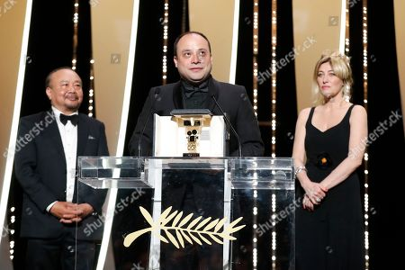 Stock Image of Guatemalan director Cesar Diaz (C) holds his the Camera d'Or Jury Prize for the movie 'Our Mothers (Nuestra Madres)' onstage next to Camera D'or JuryPresident, Cambodian-French director Rithy Panh (L) and French actress and director Valeria Bruni Tedeschi during the Closing Awards Ceremony of the 72nd Cannes Film Festival, in Cannes, France, 25 May 2019. The Golden Palm winning movie will be screened after the closing ceremony.