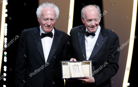 Jean-Pierre Dardenne (L) and Luc Dardenne (R) pose with the Best Director Award for the movie 'Le Jeune Ahmed' (Young Ahmed) during the Closing Awards Ceremony of the 72nd Cannes Film Festival, in Cannes, France, 25 May 2019. The Golden Palm winning movie will be screened after the closing ceremony.