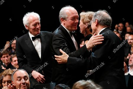 Jean-Pierre Dardenne (L) and Luc Dardenne (2-L) are congratulated before accepting the Best Director Award for their movie 'Le Jeune Ahmed' (Young Ahmed) during the Closing Awards Ceremony of the 72nd Cannes Film Festival, in Cannes, France, 25 May 2019. The Golden Palm winning movie will be screened after the closing ceremony.