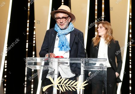 Palestine director Elia Suleiman (L) accepts the Special Mention Prize for 'It Must Be Heaven' from French actress Chiara Mastroianni (R) during the Closing Awards Ceremony of the 72nd Cannes Film Festival, in Cannes, France, 25 May 2019. The Golden Palm winning movie will be screened after the closing ceremony.