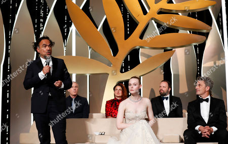 Stock Photo of Jury members: President of the Jury, Mexican director Alejandro Gonzalez Inarritu, French director Robin Campillo, Italian director Alice Rohrwacher, US actress Elle Fanning, Greek director Yorgos Lanthimos and Polish director Pawel Pawlikowski onstage during the Closing Awards Ceremony of the 72nd Cannes Film Festival, in Cannes, France, 25 May 2019. The Golden Palm winning movie will be screened after the closing ceremony.