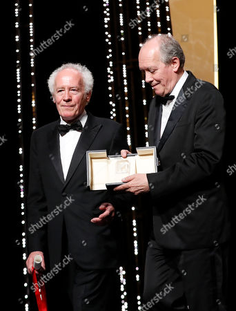 Jean-Pierre Dardenne (L) and Luc Dardenne (R) hold their Best Director Award for their movie 'Le Jeune Ahmed' (Young Ahmed) onstage during the Closing Awards Ceremony of the 72nd Cannes Film Festival, in Cannes, France, 25 May 2019. The Golden Palm winning movie will be screened after the closing ceremony.
