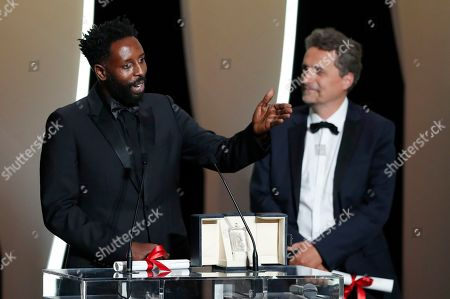 Ladj Ly (L) accepts the Jury Prize ex-aequo for his movie 'Les Miserables' next to Jury member, Polish director Pawel Pawlikowski (R) during the Closing Awards Ceremony of the 72nd Cannes Film Festival, in Cannes, France, 25 May 2019. The Golden Palm winning movie will be screened after the closing ceremony.