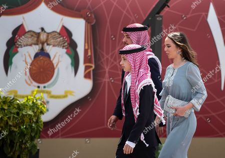 (L-R) Prince Hashem, Jordan Crown Prince Al Hussein bin Abdullah II, and Princess Lalla Salma, arrive at the ceremony of the 73th Anniversary of the Independence in Amman, Jordan, 25 May 2019.