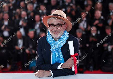 Palestine director Elia Suleiman, winner of Mention Speciale (Special Mention winner) poses during the Award Winners photocall at the 72nd annual Cannes Film Festival, in Cannes, France, 25 May 2019.