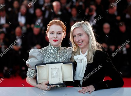 Emily Beecham (L) poses with her Best Actress Award for her performance in the movie 'Little Joe' and Austrian director Jessica Hausner (R) during the Award Winners photocall at the 72nd annual Cannes Film Festival, in Cannes, France, 25 May 2019.