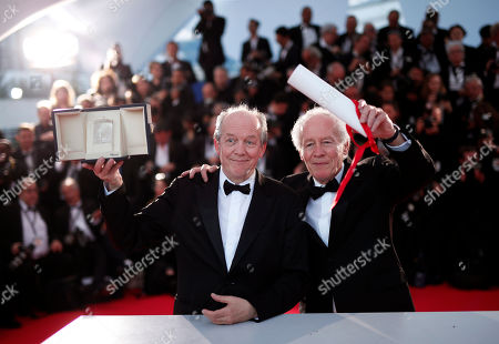 Jean-Pierre Dardenne (R) and Luc Dardenne (L) pose with their Best Director Award for 'Le Jeune Ahmed' (Young Ahmed) during the Award Winners photocall at the 72nd annual Cannes Film Festival, in Cannes, France, 25 May 2019.