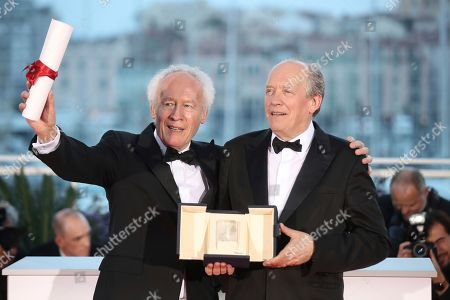 Jean-Pierre Dardenne, Luc Dardenne. Directors Jean-Pierre Dardenne, left and Luc Dardenne hold their best director award for the film 'Young Ahmed' as they pose for photographers during a photo call following the awards ceremony at the 72nd international film festival, Cannes, southern France