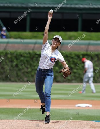 Aimee Garcia, actress & Chicago native, throws out the ceremonial first pitch before a baseball game between the Cincinnati Reds and the Chicago Cubs, in Chicago
