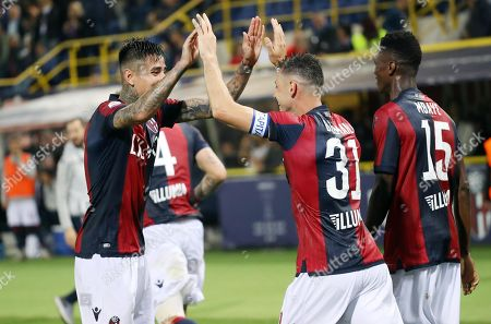 Bologna's Blerim Dzemaili (2-R) celebrates with teammates scoring during the Italian Serie A soccer match between Bologna FC and SSC Napoli at the Renato Dall'Ara stadium in Bologna, Italy, 25 May 2019.