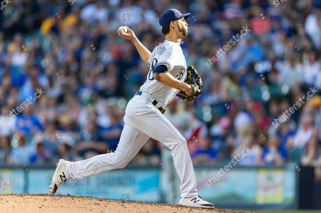 Milwaukee Brewers relief pitcher Alex Claudio #58 delivers a pitch during the Major League Baseball game between the Milwaukee Brewers and the Philadelphia Phillies at Miller Park in Milwaukee, WI