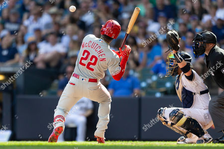 A pitch sails over the head of Philadelphia Phillies Andrew McCutchen #22 during the Major League Baseball game between the Milwaukee Brewers and the Philadelphia Phillies at Miller Park in Milwaukee, WI