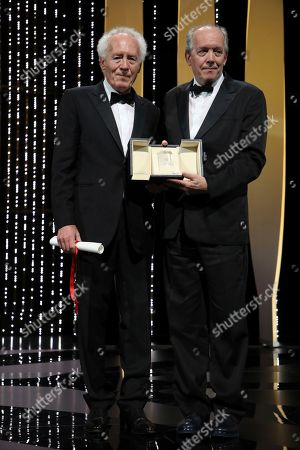 Jean-Pierre Dardenne, Luc Dardenne. Directors Jean-Pierre Dardenne, left, and Luc Dardenne hold their best director award for the film 'Young Ahmed' during the awards ceremony at the 72nd international film festival, Cannes, southern France