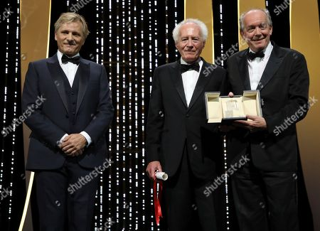 Jean-Pierre Dardenne, Luc Dardenne, Viggo Mortensen. Directors Jean-Pierre Dardenne, centre, and Luc Dardenne, right, hold their best director award for the film 'Young Ahmed' presented by actor Viggo Mortensen, left, during the awards ceremony at the 72nd international film festival, Cannes, southern France