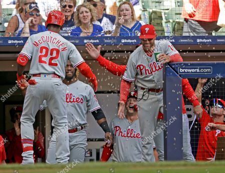 Philadelphia Phillies' Andrew McCutchen (22) is showered with sunflower seeds after his home run against the Milwaukee Brewers during the first inning of a baseball game, in Milwaukee