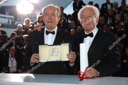 Luc Dardenne, Jean-Pierre Dardenne. Directors Luc Dardenne, left and Jean-Pierre Dardenne hold their best director award for the film 'Young Ahmed' as they pose for photographers during a photo call following the awards ceremony at the 72nd international film festival, Cannes, southern France