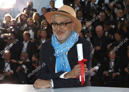 Elia Suleiman, winner of the special mention award for the film 'It Must Be Heaven' poses for photographers during a photo call following the awards ceremony at the 72nd international film festival, Cannes, southern France