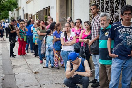 People wait to receive humanitarian aid in Caracas, Venezuela, on 25 May 2019. Rescate Venezuela, promoted by Venezuelan opposition leader Leopoldo Lopez and his wife Lilian Tintori, delivered on 25 May basic hygiene products packages to more than 500 families in Caracas as part of their plan to distribute aid.