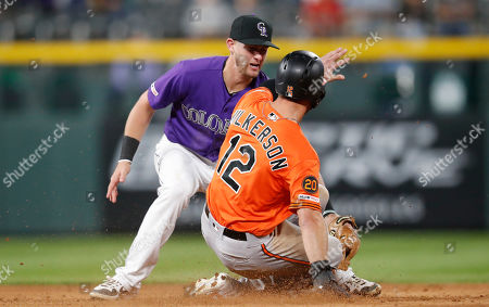 Stock Image of Ryan McMahon, r m. Colorado Rockies second baseman Ryan McMahon, back, tags out Baltimore Orioles' Stevie Wilkerson on an attempted steal of second during the ninth inning of a baseball game, in Denver. Baltimore won 9-6