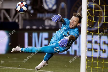 Portland Timbers' Steve Clark blocks a shot during the second half of an MLS soccer match against the Philadelphia Union in Chester, Pa
