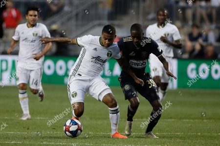 Portland Timbers's Andy Polo and Philadelphia Union's Jamiro Monteiro vie for the ball during the first half of an MLS soccer match in Chester, Pa