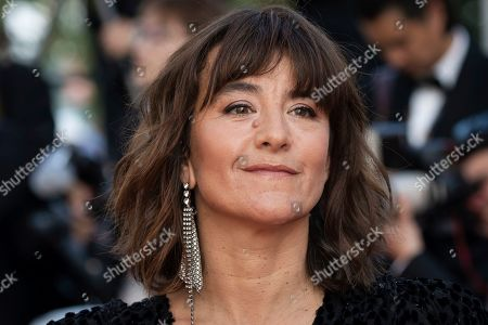 Romane Bohringer poses for photographers upon arrival at the awards ceremony of the 72nd international film festival, Cannes, southern France