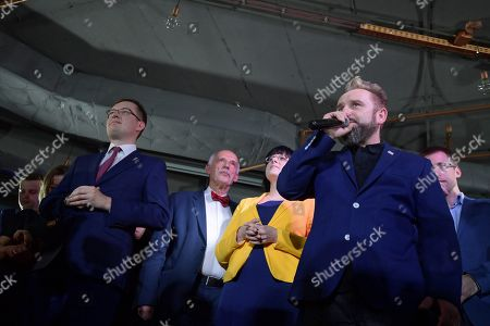 (L-R) Robert Winnicki, Janusz Korwin-Mikke, Kaja Godek and Piotr Liroy-Marzec of Confederation Korwin Braun Liroy Nationalists react after the announcement of the exit polls of the European elections in Warsaw, Poland, 26 May 2019. The European Parliament election is being held by member countries of the European Union from 23 to 26 May 2019.