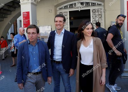 Spanish People's Party leader, Pablo Casado (C), and his party's candidates for Madrid's Mayor Jose Luis Rodriguez Almeida (L) and for Madrid's Regional President Isabel Ayuso (2-R) leave a polling station in Madrid, Spain, 26 May 2019. Spain holds locals, regional and European Parliament elections. The European Parliament election is held by member countries of the European Union (EU) from 23 to 26 May 2019.