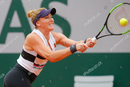 Madison Brengle of the U.S. plays a shot against Krystina Pliskova of the Czech Republic during their first round match of the French Open tennis tournament at the Roland Garros stadium in Paris